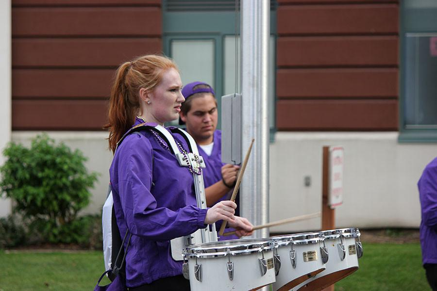 Senior McKenzie Davidson gets ready for the march to the match on 9/18/15.