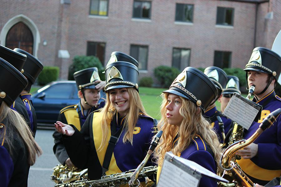 Junior Simone Stapley smiles as she gets ready to march to the match on 9/18/15 with the band.