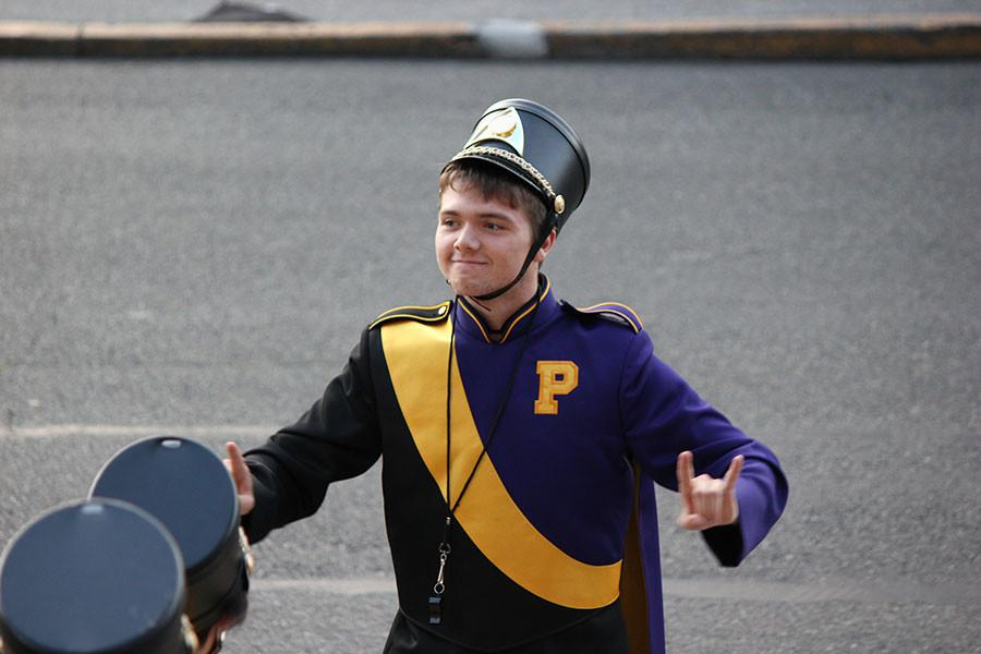 Senior Brandon Sujka leads the Puyallup High School band in preparation for the march to the match on 9/18/15.