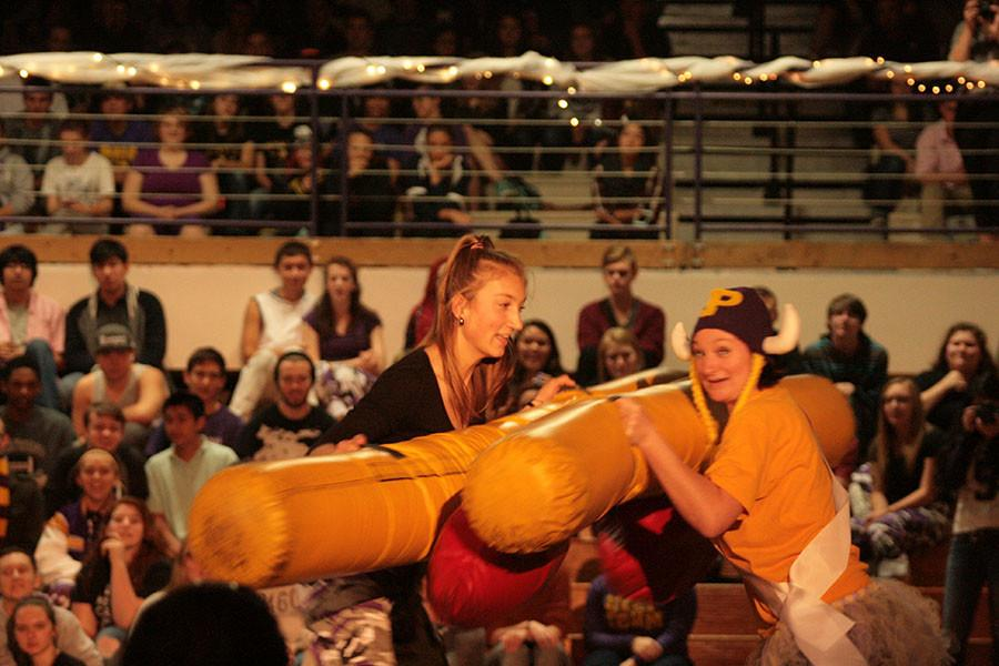 Teacher Mrs. Coyer and junior Grace Wood wrestle at the homecoming assembly on 10/16/15. Grace and Coyer go head to head with Grace ending up winning for the junior class.