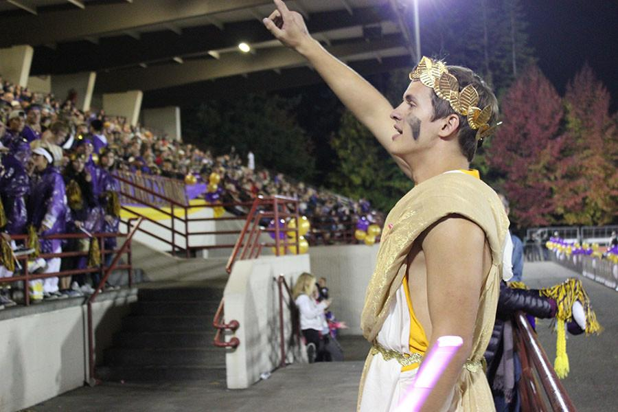 Senior Nick Fraser leads the Viking student section in a cheer at the homecoming game on 10/16/17