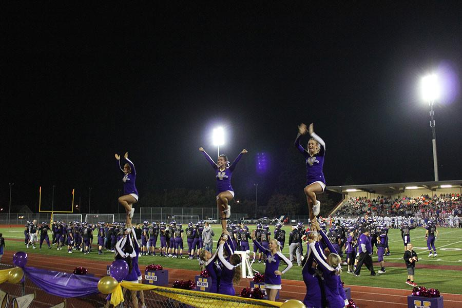 The cheer squad does stunts at the homecoming game on 10/16/15