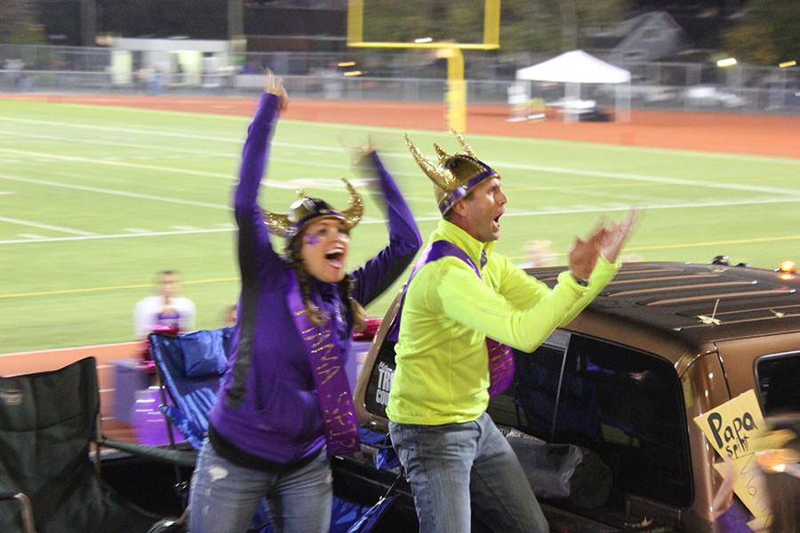 Mama Spirit Jamie Mooring, and Papa Spirit Matt White go crazy while going past the student section at the homecoming game on 10/16/15