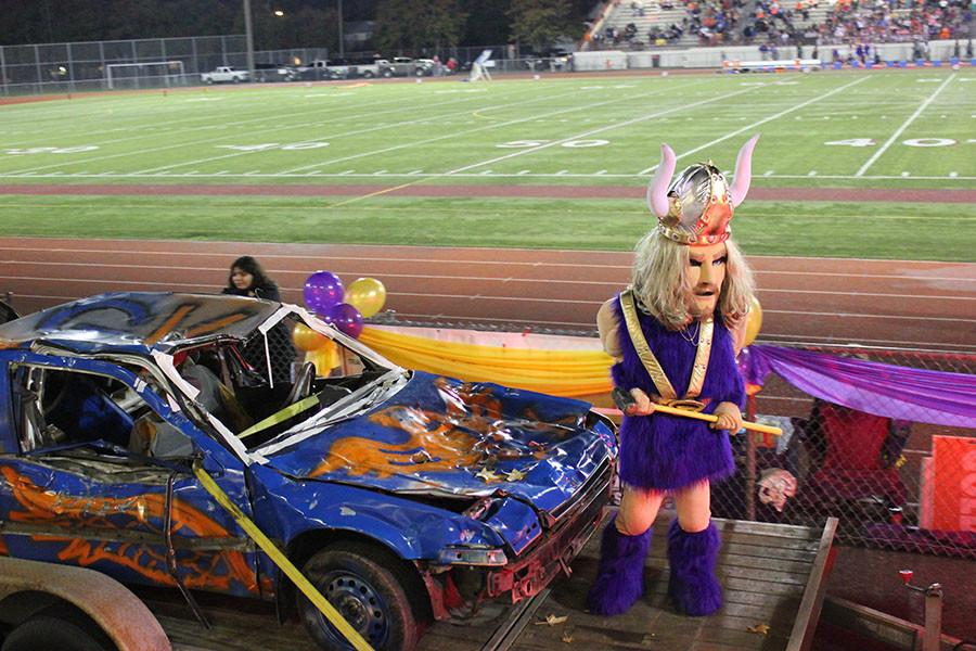 Victor Viking goes on the car smashing float at the homecoming game on 10/16/15/.