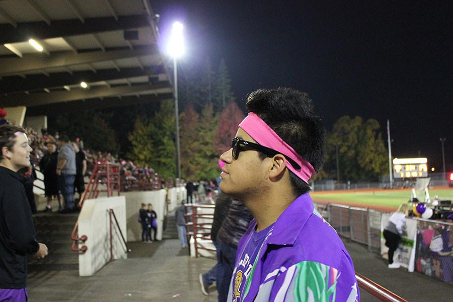 Senior Gerardo Zaragoza stands waiting to lead the student section in a cheer at the football game against Timberline on 10/23/15.