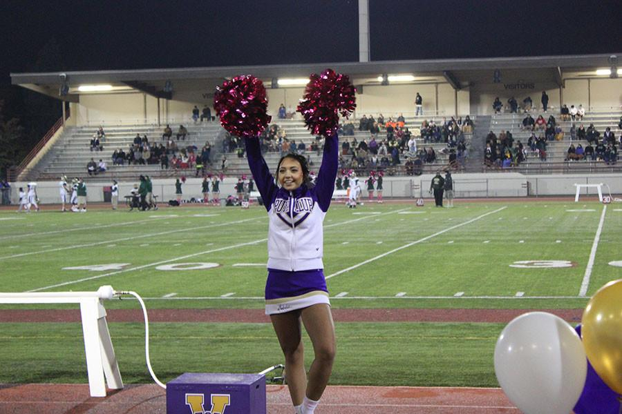 Senior Mikela Pedro Ventura cheers at the football game against Timberline on 10/23/15.