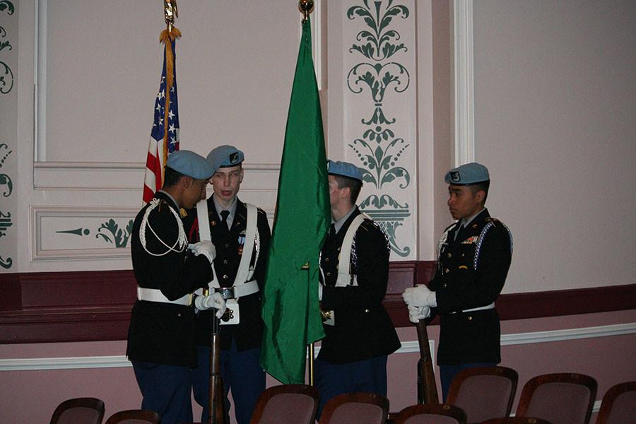 A candid picture of the ROTC Color guard. At the Veterans day assembly.