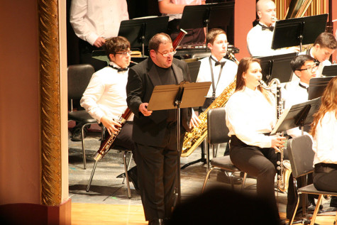 Mr. Sirl, Narrating the story of the evening. At the December band concert.