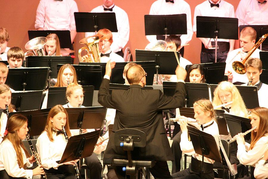 Mr. Ryan conducting the band. At the December band concert.