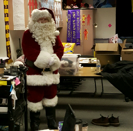 Santa Clause gets ready  to grant some early winter wishes. On an early Friday morning in December Clause monitors his hard working elves in the leadership classroom.