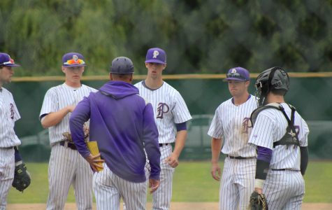 Coach Marc Wiese goes out to meet the infield during PHS' 6-2 victory against Kentwood High School.