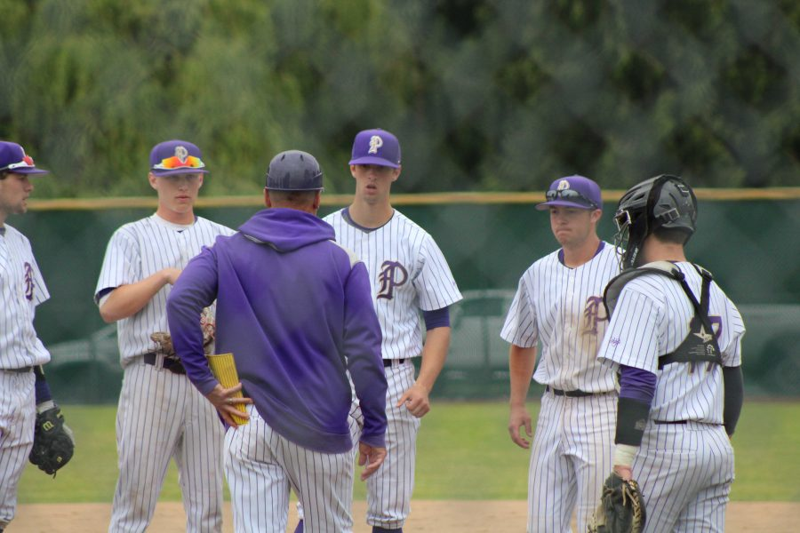 Coach+Marc+Wiese+goes+out+to+meet+the+infield+during+PHS%27+6-2+victory+against+Kentwood+High+School.+