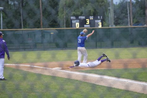 Shortstop Michael Spellacy slides into third during PHS 4-3 victory against the Kentwood Chargers.