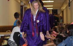 Graduates participate in parade at elementary schools