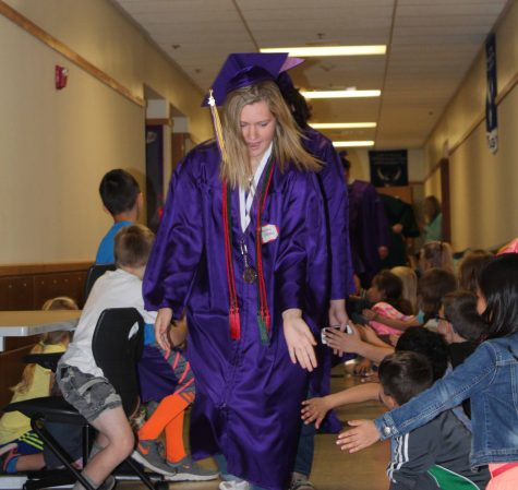 Senior Maddy Wheless walks the halls of Meeker Elementary June 17 after graduation practice. This process was repeated at other elementary schools throughout the district.