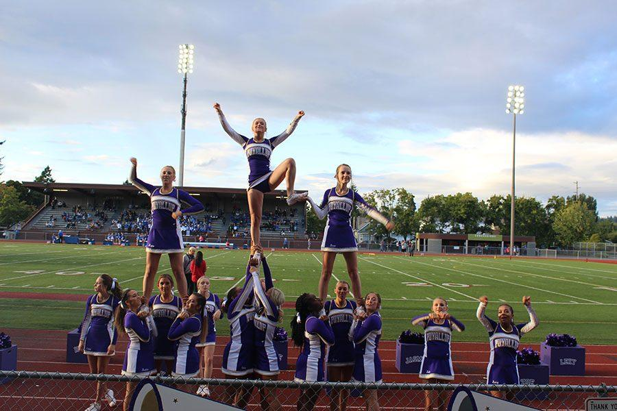 The cheerleading team is stunting while helping cheer on the Vikings on 9/2/16.