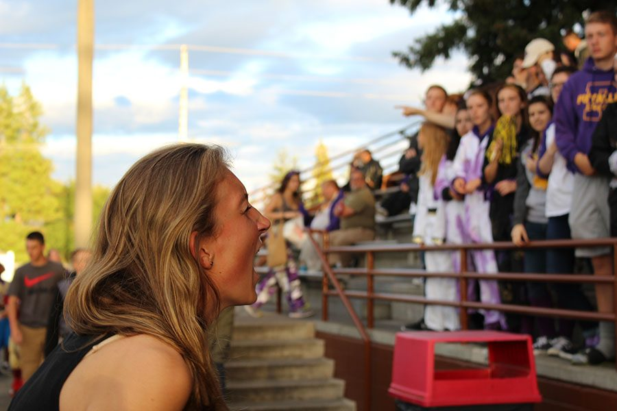 Senior Grace Wood leads the student section at the first home game on 9/2/16.