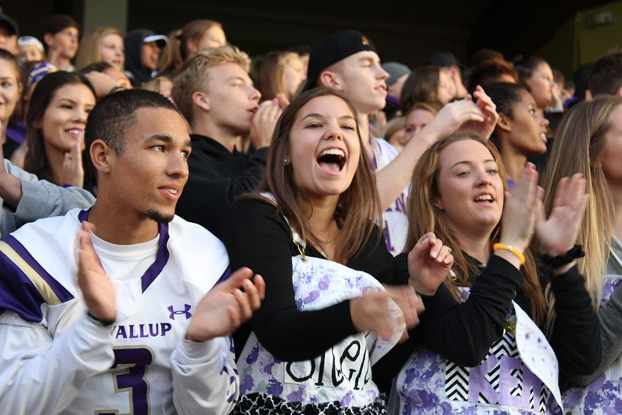 Seniors Henry Search, Shelby Stiffarm and McKenna Winter cheer on the Vikings on 9/16/16.