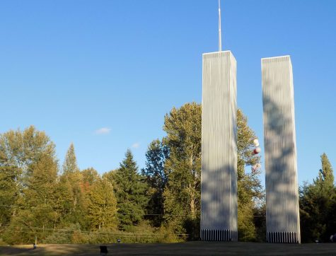 """In honor of 9/11, Tim Jorgenson built replicas of the twin towers for his front yard. They are at the corner of 108th Ave. and 36th St. in Edgewood for people to come pay respect and honor what was lost. """"My heart goes out to them [those that lost someone]. It affected every one of us, in some way or another,"""" he said."""
