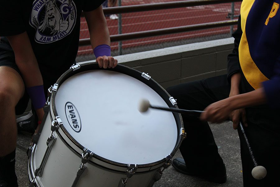 Senior Luke Maghirang leads boom clap by playing the bass drum at the PHS vs. Rogers game on 9/16/16.