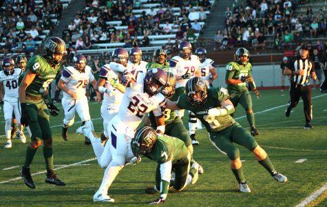 Senior Honore Thomas taking on multiple Emerald Ridge Jaguar defenders in their game against them Sept. 9.