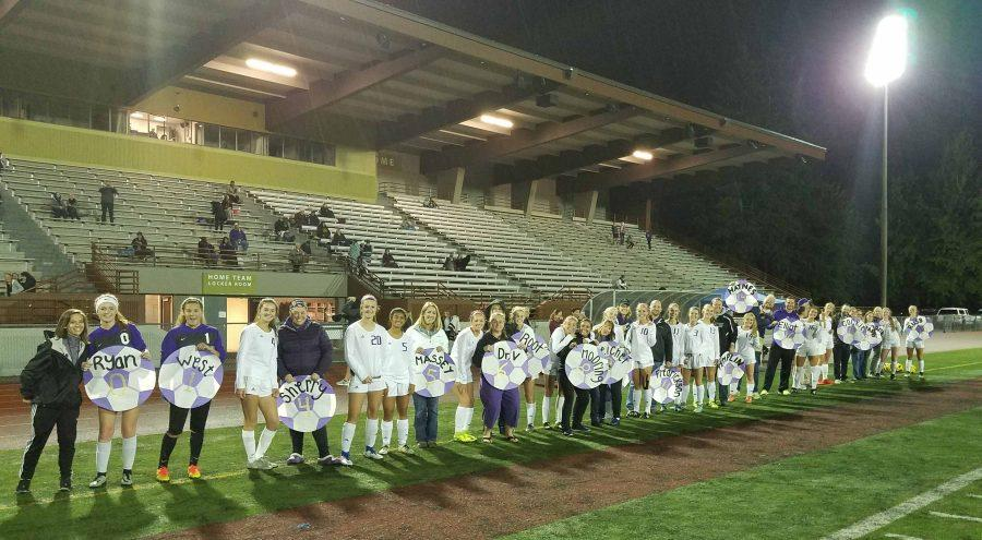 Senior soccer players honor teachers