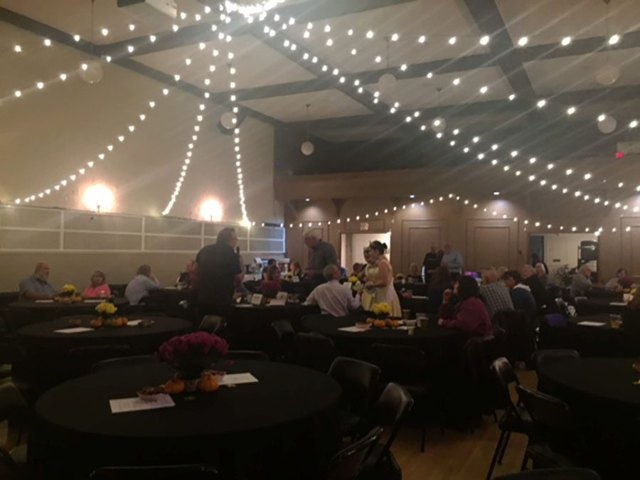 The banquet hall was decorated with string lights. Puyallup High School Alumni Association held a fundraiser night at Station House 726 in downtown Puyallup Saturday Nov. 5. The night was filled with auctions, music, dancing and dinner, all to help raise money for scholarships.