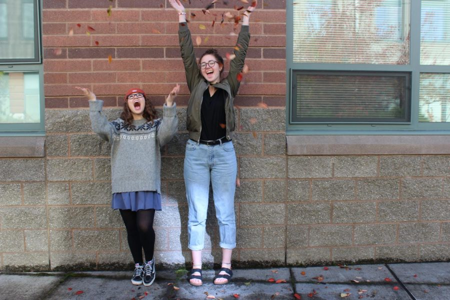 Seniors, Jory Duvall and Taylor Frey, jumping into the fall season. Taylor is modeling an oversized sweater on top of a dress with some tights and old-skool Vans sneakers, a current fall fashion trend.
