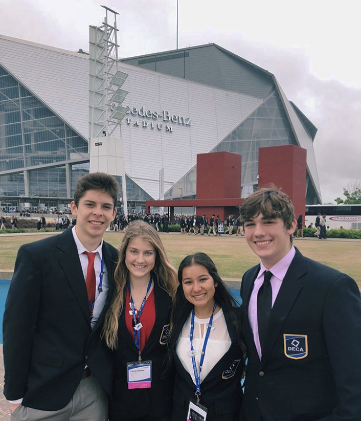 Ben Rodriguez, Carisa Steimle, Dharma Shah and Toren Herrick pose in front of the Mercedes-Benz Stadium at the national DECA competition in Atlanta, GA.