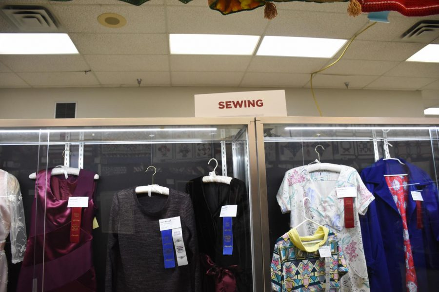 There were many entries in the sewing contest this year. From what was captured in this picture there were three red ribbons, two blue ribbons, and one white ribbon with one of the blue.