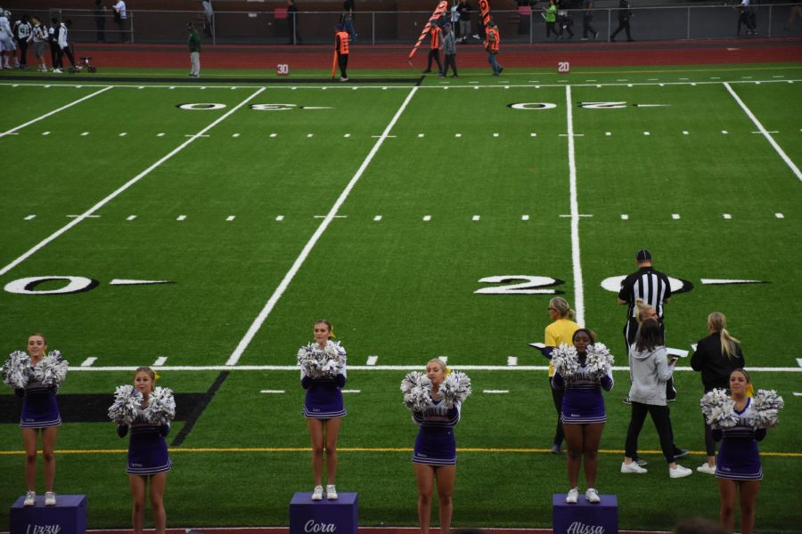 The cheer team had been cheering on the Vikings all night and while supporting the Viks hyping up the crowd. Some of the cheerleaders present who were in this photo were Lizzy Ostlund, Sydney Carey, Cora Suarez, Reese McLean, Alissa Handley, Taylor Rolfness.