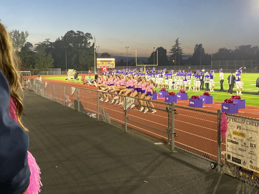 The cheerleading team during the match, dancing and singing to show their support. Giving a boost to the spirits in both the crowd and on the field. Puyallup football team against Olympia's on October, 11 at 7 p.m.