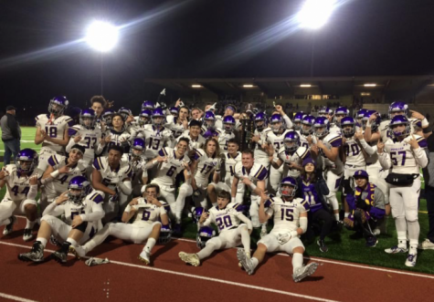 Puyallup High School football team with the Sparks City Trophy